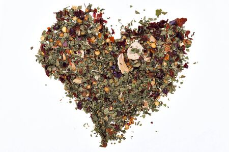 heart made with various spices on white background photo