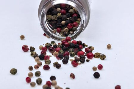 peppercorns spilled on a white background Stock Photo - 16992726