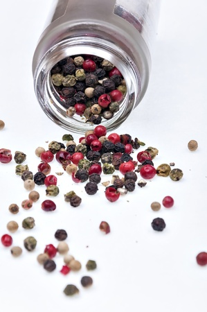peppercorns spilled on a white background