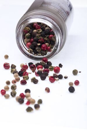 peppercorns spilled on a white background Stock Photo - 16992725