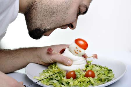 man eating mozzarella