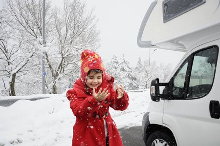 child and camper with snowy background Stock Photo