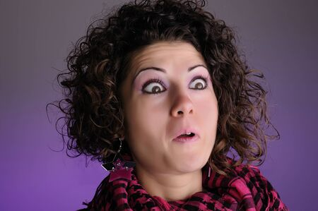 face of young woman with surprise expression