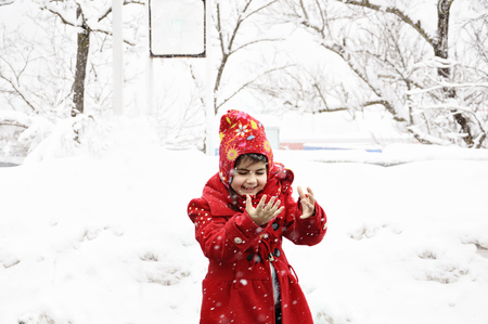 little girl surprised to see the snow