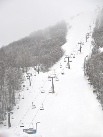 ski lift ski slope with fog