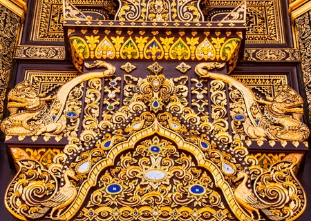Beautiful temple door in the north of Thailand photo