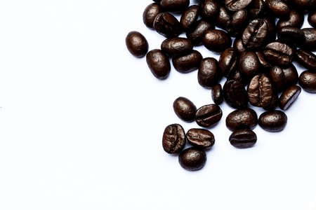 Close-up of coffee beans scattered. Background