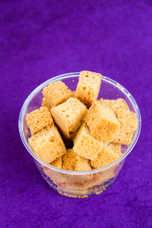 Baked raw rusks in a wooden table. Stock Photo