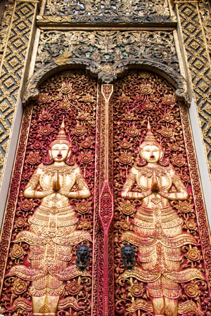 Ancient golden carving wooden window of Thai temple. Thailand photo
