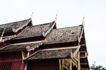 View of a Viharn and Stupa at the historic Buddhist temple of Wat Phra Singh, Chiang Mai, Thailand