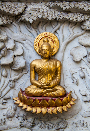 Ancient golden carving wooden window of Thai temple. Thailand