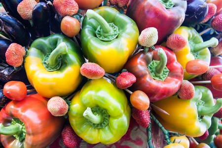 Yellow, green and red colorful bell peppers, natural background Stock Photo