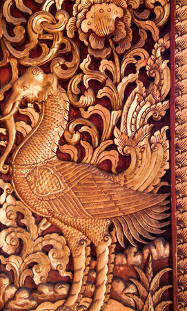 Wooden doors carved into lotus, decorated with stained glass, Thai Art. Editorial