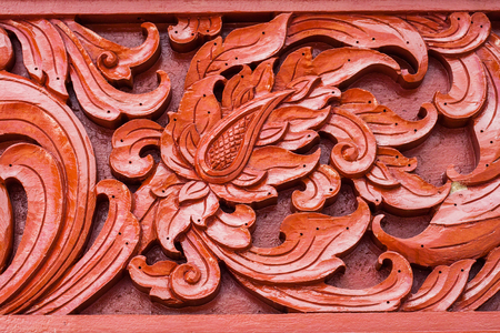 woodcraft: Pattern of carved on wood background on the wall of temple Thailand