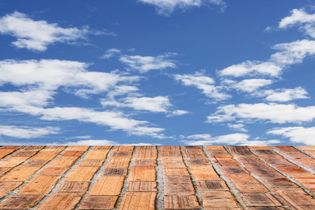 brick wall texture with blue sky background