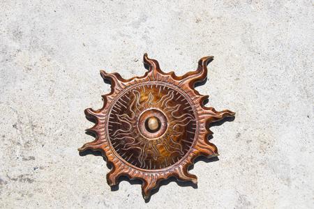 Wooden sun symbol
