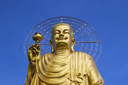 power giant: A large statue of golden Buddha. Dalat Vietnam