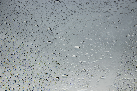 inclement weather: Water drop on glass mirror background Stock Photo