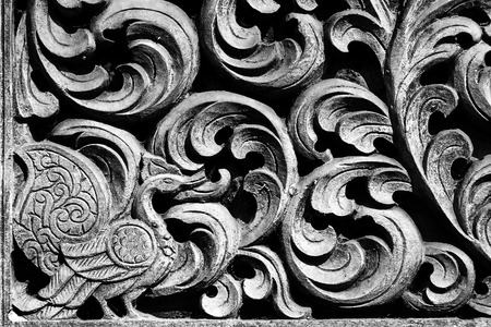 Wood carving decorated at windows of the temple Stock Photo