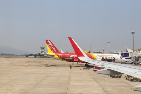 Chiangmai, Thailand - March 15, 2018: Passengers boarding on VietJet airplane in chiangmai airport. Editorial