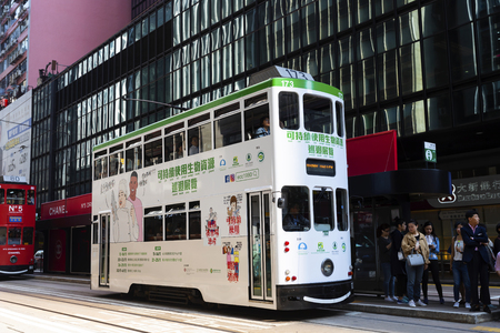 Causeway Bay, Hong Kong - 23 November 2018: Double-decker tram Trams are also a major tourist attraction and one of the best eco-friendly travel destinations in Hong Kong. Editorial