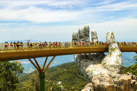 Danang, Vietnam - JUNE, 24, 2019: The Golden Bridge in the Bana Valley, supported by a giant hand This bridge is 1,400 meters above sea level.