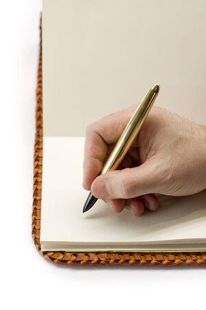Writing in blank book Stock Photo