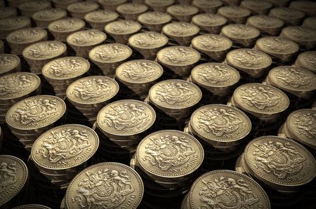 debt collection: Stacks of one pound coins