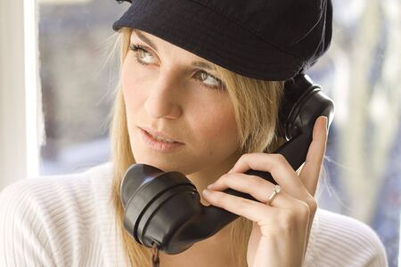 Lady talking on old telephone