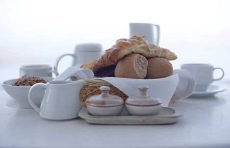 Continental breakfast against white background photo