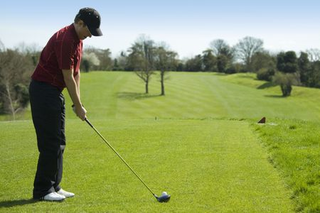 off course: Golfer teeing off
