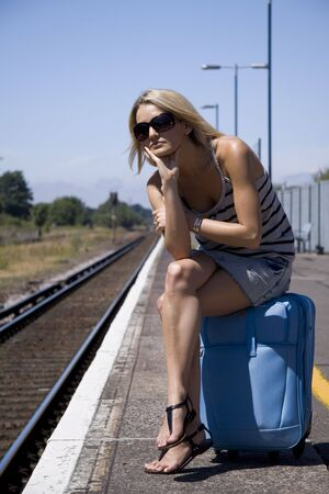 Lady waiting for train Stock Photo