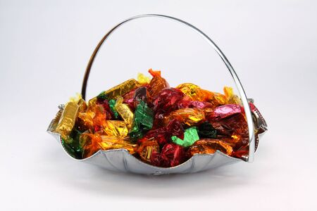 Isolated bowl of assorted chocolate sweets
