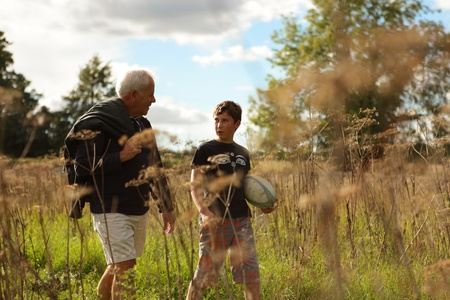 Father and son walking in a field