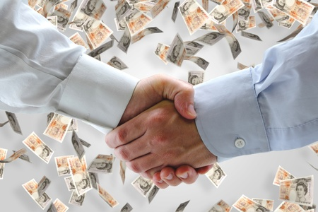 Business handshake with falling money