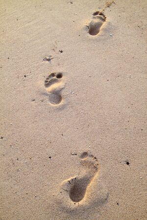 Footprints in the beach sand Stock Photo