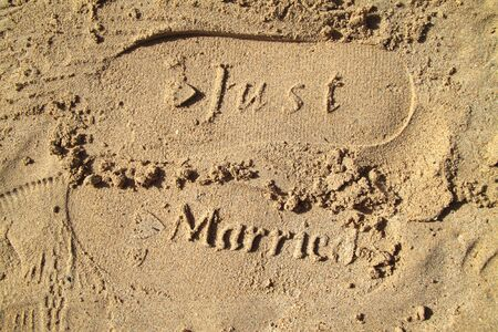 Just married imprint in the sand photo