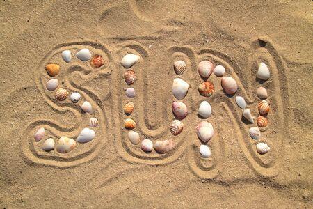Sun written in the sand Stock Photo