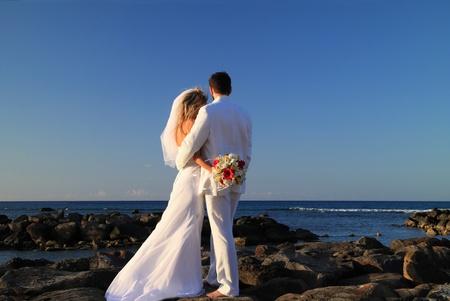 Married bride and groom beach wedding