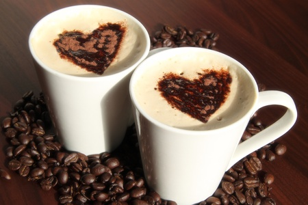 Cups of coffee with heart shapes