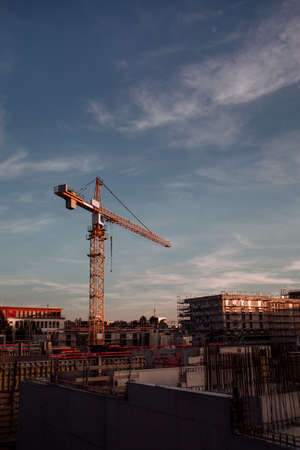 construction crane and construction site during sunset