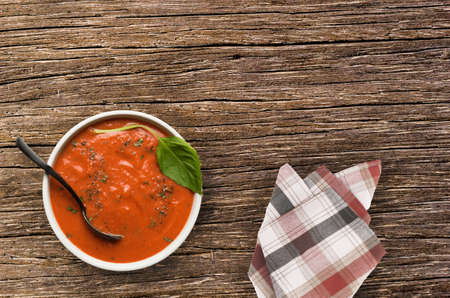 roasted tomato basil soup on wooden table
