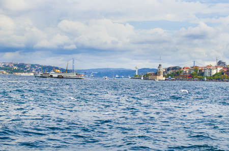 Ferries over the Istanbul Strait, the maidens tower and the 15th July Martyrs Bridge at the back