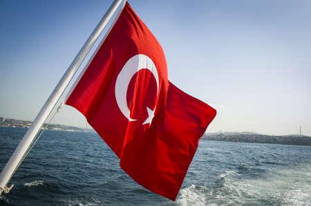 flag of turkey and lifebuoy on back of a boat in bosphorus strait istanbul turkey Stockfoto
