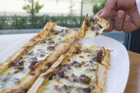 konya: turkish traditional pita pide cheese and meat