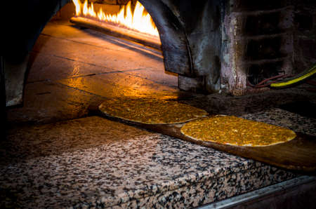 fireplace: turkish pita, lahmacun baked in stone oven Stock Photo