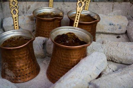 preparing coffee in pots on hot coals Archivio Fotografico