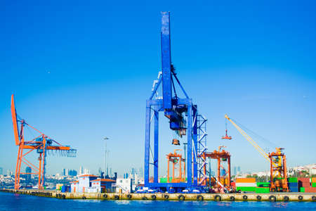 industrial container freight and containers loading shipping by crane at trade port Stock Photo