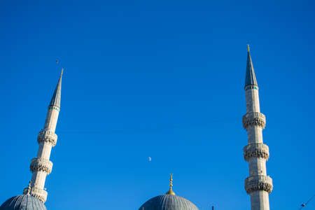 New mosques minaret with crescent moon in the blue sky istanbul turkey Stock Photo
