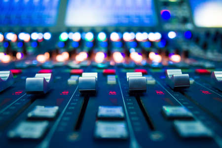 detail of a music mixer in studio dj working for new tracks music production with editing tools